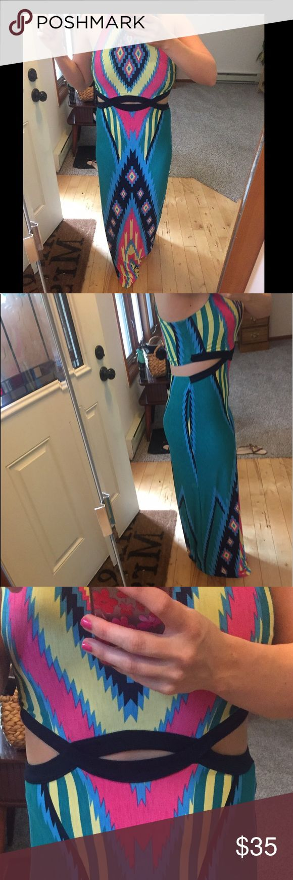 Amazing Aztec maxi nwot Literally love this dress but have never worn it besides to try on. Amazingly soft material. I am 5'3. Front cut outs. Back looks like two pieces but is one piece. Summer, festival, bright, sexy. Make reasonable offer. I am usually a 6/7 in dresses and this fits perfect. So medium or large. **NOT URBAN** tagged for exposure. From pink lily boutique. Urban Outfitters Dresses Maxi