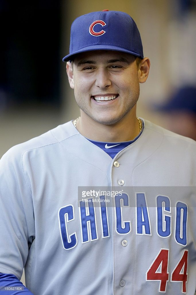 Anthony Rizzo #44 of the Chicago Cubs gets ready in the dugout before the game against the Milwaukee Brewers at Miller Park on August 21, 2012 in Milwaukee, Wisconsin.: