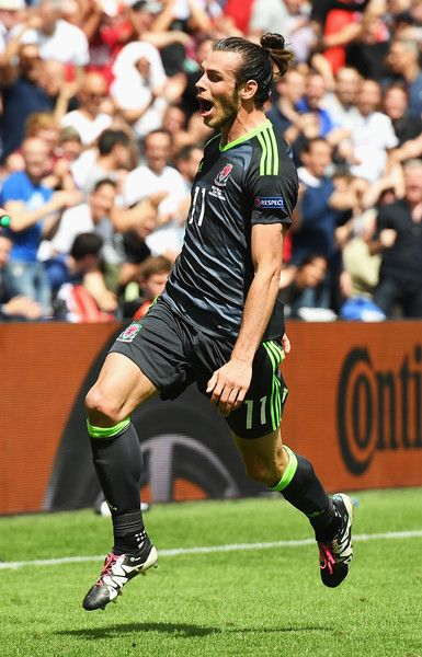 Gareth Bale of Wales celebrates after scoring the first goal during the UEFA EURO 2016 Group B match between England and Wales at Stade Bollaert-Delelis on June 16, 2016 in Lens, France.