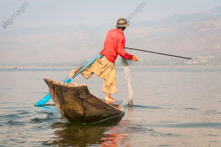 Intha fisherman fishing in a traditional fishing boat, Inle Lake, Nyaung Shwe, Shan State, Myanmar, (Burma)