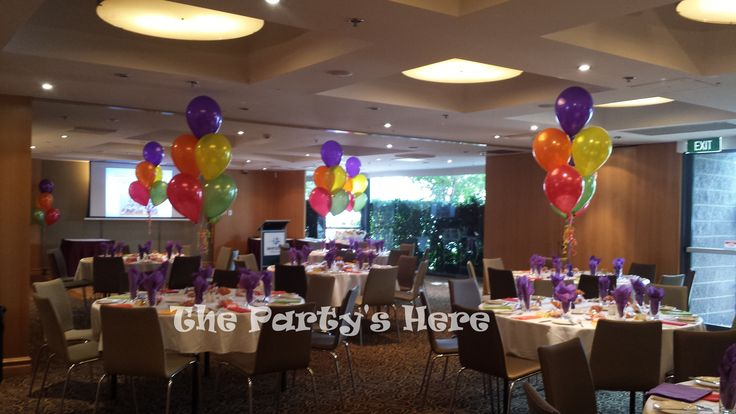 Helium Bouquets with 5 balloons for a rainbow themed Year 6 Farewell Party.  www.thepartyshere.com.au  #balloons #rainbow #party #year6 #graduation #school #farewell #celebration #balloondecorating #decorations #colours