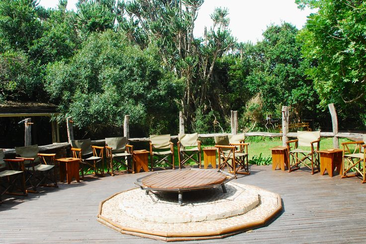 The Boma area all set up for time around the fire at night At Sibuya Game Reserve Forest Camp reached via boat along the Kariega River from Kenton on Sea, Eastern Cape, South Africa www.sibuya.co.za