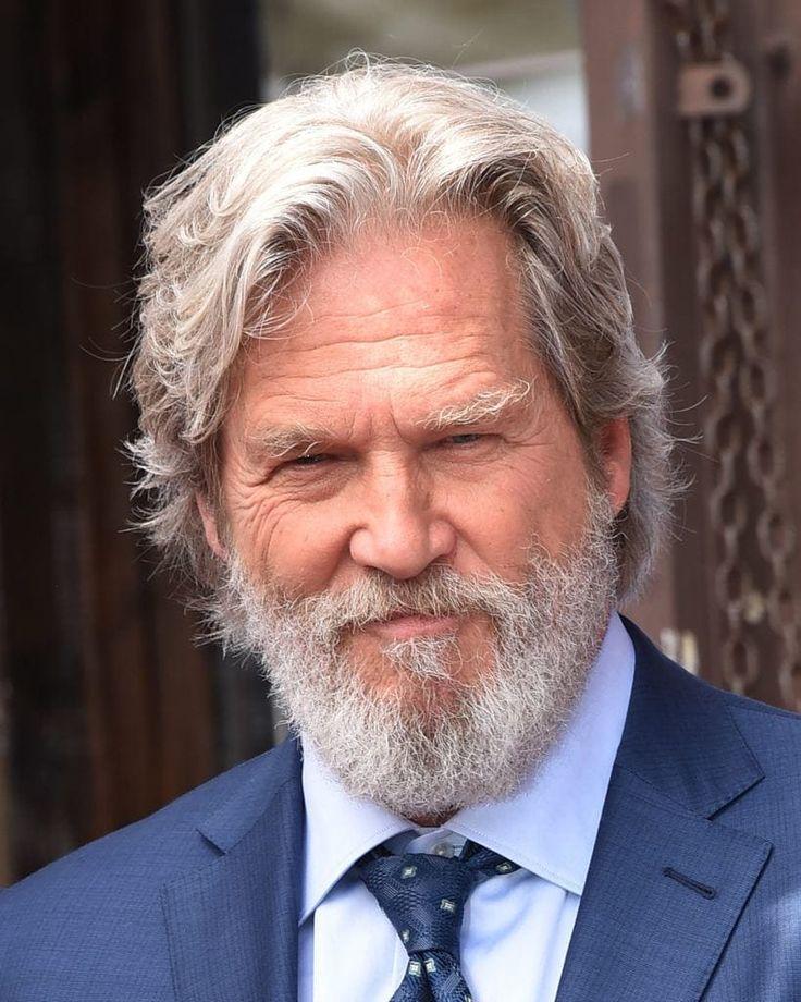 Jeff Bridges wearing a blue suit with a light blue shirt ...