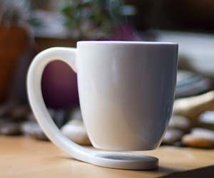 Floating Coffee Mug - Keep your tables clean without needing a drink coaster with these floating coffee mugs. Using a clever support system, the coffee mug floats in the air, keeping your table top safe from hot coffee leaving behind a mark – and its unique shape is surprisingly durable too.
