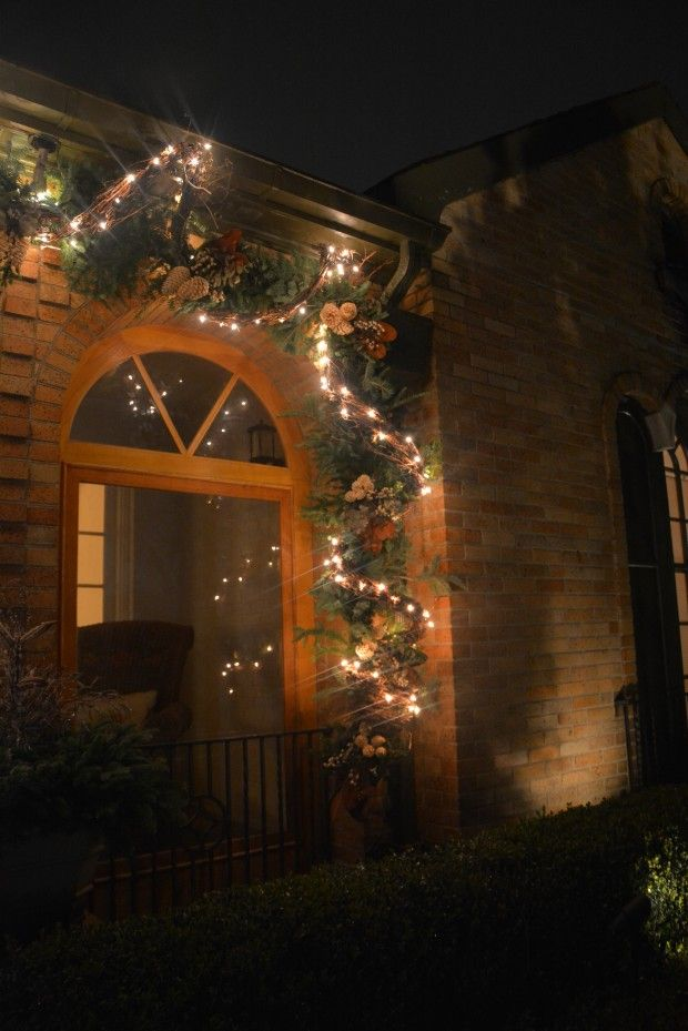 Doorway decor | Clear lights | Grapevine garland | Evergreen garland | Pinecones | Magnolia | Eucalyptus