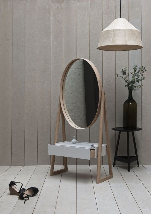 The proportions are odd to me, but love the minimalist take on a traditional vanity.