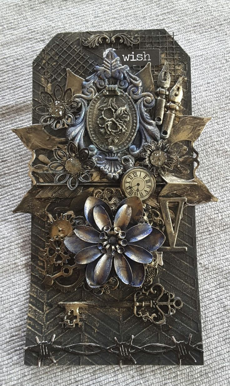 Mixed media tag made with the Metallic wax from Finnabair