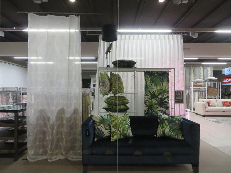 White shimmering sheer Fabric: Valencia. Geometric Embroidered Sheer fabric: Reflect. Cushions fabric: Shangri-la collection. Custom Design Sofa fabric: Zegna. www.lahood.co.nz