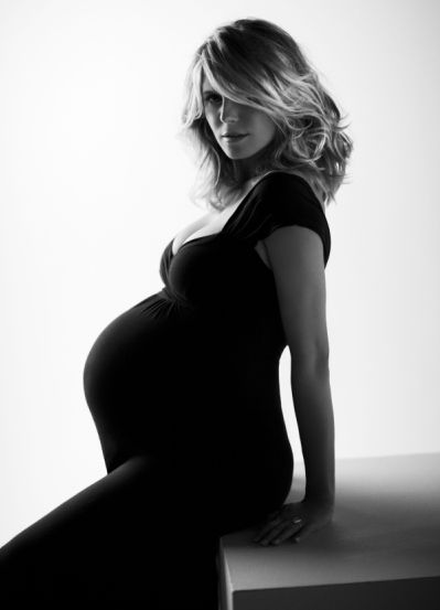 I just love this photo so much! I actually tried to use this pose while taking self portraits of myself 8 month pregnant with twins. Results: I'm no Heidi:)