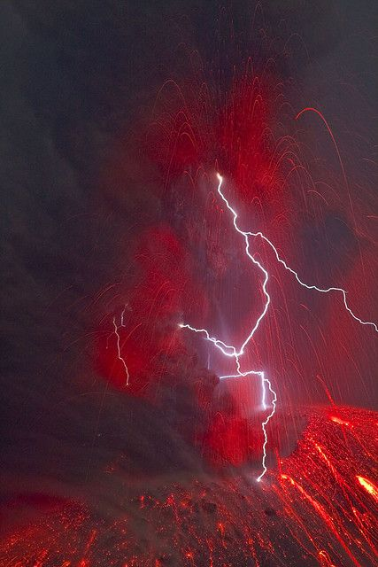 Eruption lightning at Krakatau   One of the rare (every 2-12 hrs approximately) vulcanian-type explosions at night with a large lightning forming inside the turbulent ash cloud. (1 Sep 09). Photography by Tom Pfeiffer