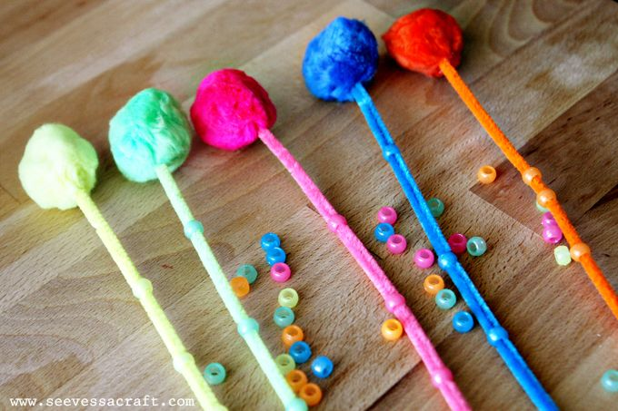 fine motor Lorax activity. glue pompom to pipe cleaner and have children match beads to same colored truffela tree
