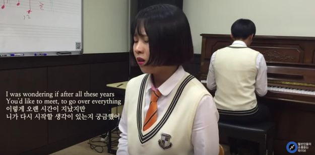 """The video starts with a girl in a school uniform passionately singing the song, while another student plays piano in the background. 