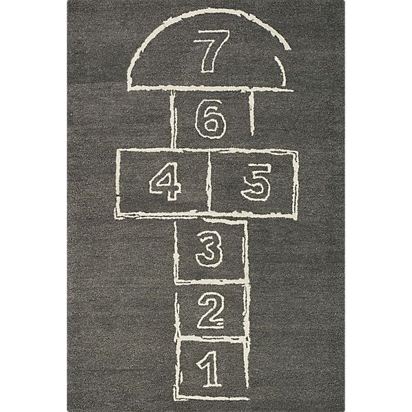 hopscotch rug -- $199 (I like this best -- the muted grey is good if we're going to have other colors elsewhere, while the chalk motif is playful)