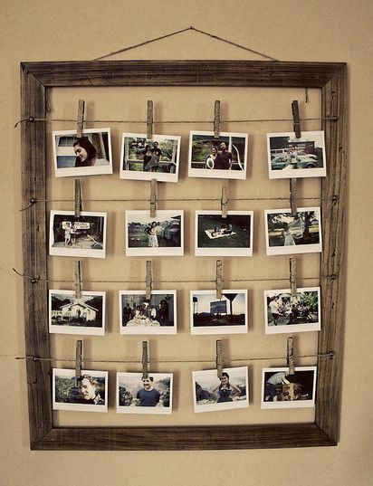 Photo display made from a wood lattice and clothespins. Love this.