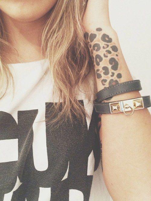 leopard print tattoo.