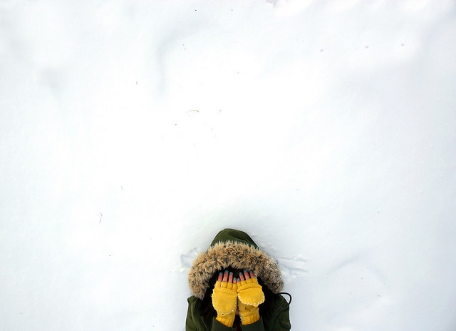 composition love. yellow mittens