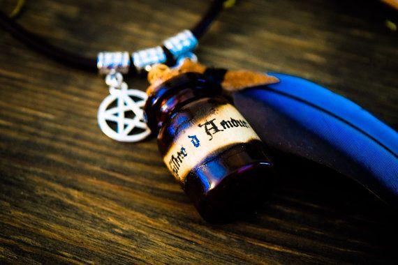 Collier pendentif philtre d'amour et plume de par XtazikCreations
