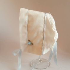 I designed this adorable bonnet for the newborns. It both can be used for special days, celebrations like christening, coming home. I think this baby hat is very elegant.. its main material is linen fabric.. i also used festoon, rose and ribbon. This bonnet is a custom made, and therefore is