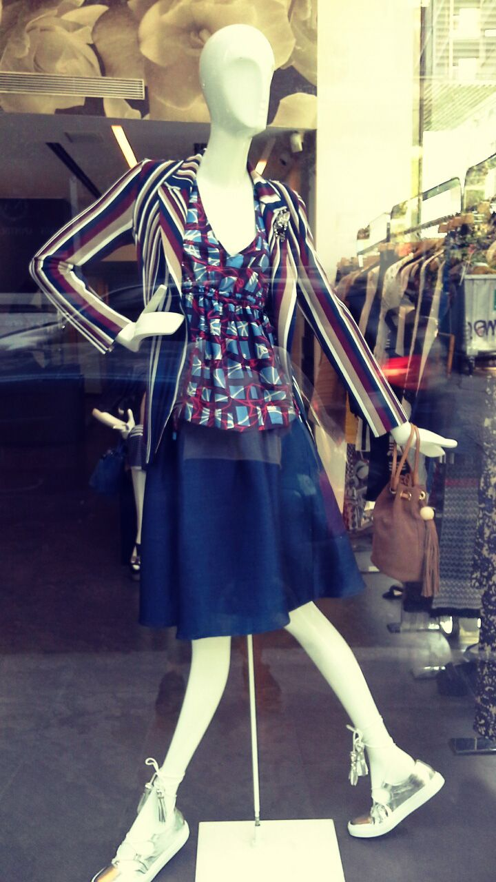 Geelists Window Front: Knitted jacket Terre Alte  Shirt and shoes L'autre Chose  Skirt from Space Style Concept.