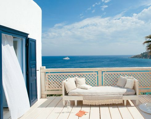 When I stumbled upon the gorgeous Mykonos Blu Resort I knew I wanted to take you on a tour. It's a great example of Greek decor style!    Bright white stucco buildings against the beautiful blue Aegean Sea -that's Greece!