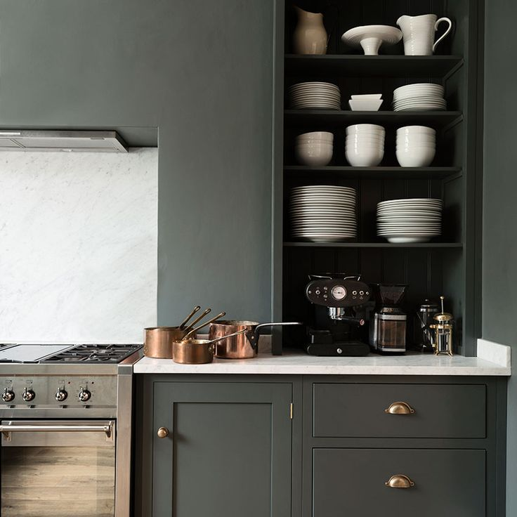 Use a modishly modern paint palette and on-trend details to update a traditional kitchen. This Shaker-style design by Devol is brought bang up to date with a marble surface and splashback, moody grey paint and luxurious brass fittings, as well as the latest range cooker by Smeg. 'Real Shaker' kitchen in 'Flint', from £8,000, Devol (devolkitchens.co.uk)