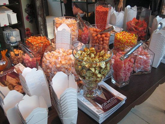 Colored candies in differing glass jars for outdoor wedding decor/snacks (day time wedding, same colors of the wedding)