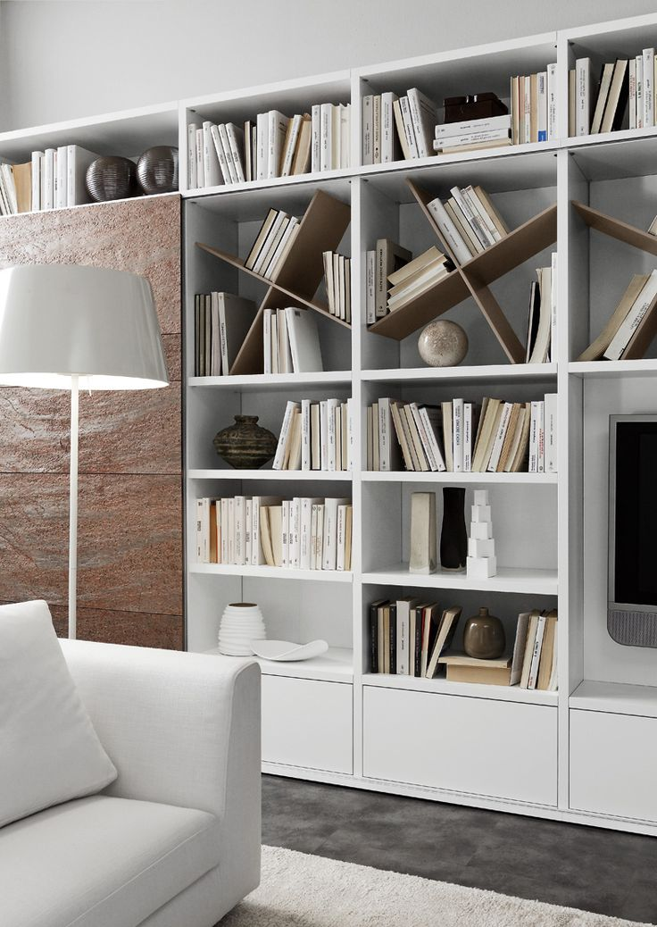 PRESOTTO | Pari & Dispari bookcase with matt marrone daino lacquered Cross shelf and a matt bianco candido lacquered back panel; sliding door in Cooper stone. _ Libreria Pari & Dispari con ripiano Cross laccato opaco marrone daino e schienale laccato opaco bianco candido; anta scorrevole in pietra Cooper.