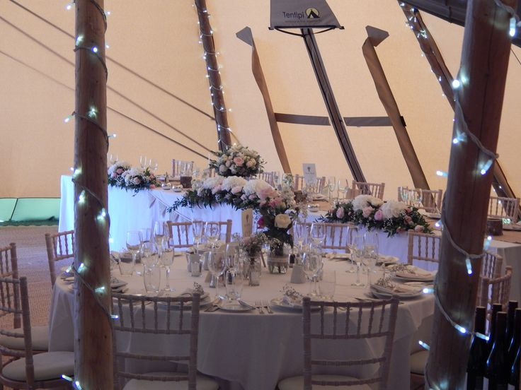 View of the top table and a guest table set up and waiting for the arrival of the wedding party!