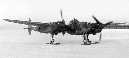 P-38G Lightning aircraft with retractable ski landing gear, Ladd Field, Fairbanks, US Territory of Alaska, winter of 1943-1944, photo 1 of 2