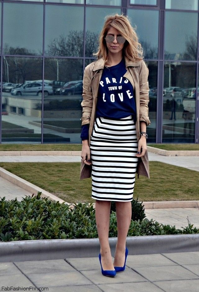 Black and white striped pencil skirt, navy graphic tee, navy heels, tan trench coat