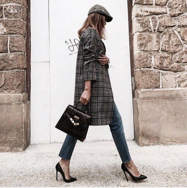Plaid coat, black heels, hat, denim jeans