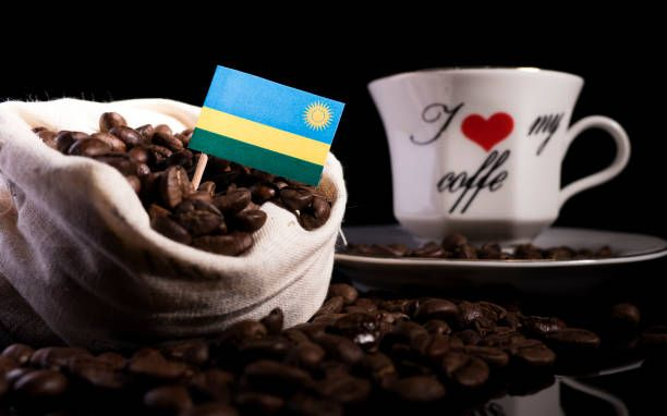 rwanda flag in a bag with coffee beans isolated on black background