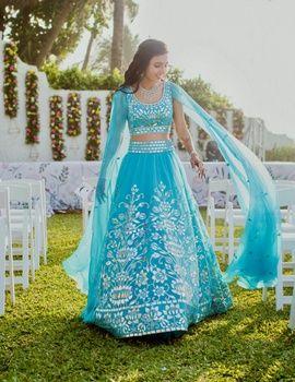 Sangeet Lehengas - Masoom and Shailin | WedMeGood | Masoom in a Aqua Blue Lehenga with Silver Embroidery and Open Flared Sleeves  #wedmegood #indianbride #indianwedding #blue #aquablue #silver #embroidery #lehenga #bridal  For more on this wedding visit: www.wedmegood.com