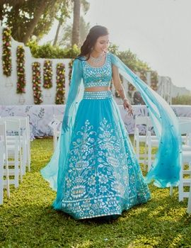 Sangeet Lehengas - Masoom and Shailin | WedMeGood | Masoom in a Aqua Blue Lehenga with Silver Embroidery and Open Flared Sleeves #wedmegood #indianbride #indianwedding #blue #aquablue #silver #embroidery #lehenga #bridal For more on this wedding visit: www.wedmegood.com