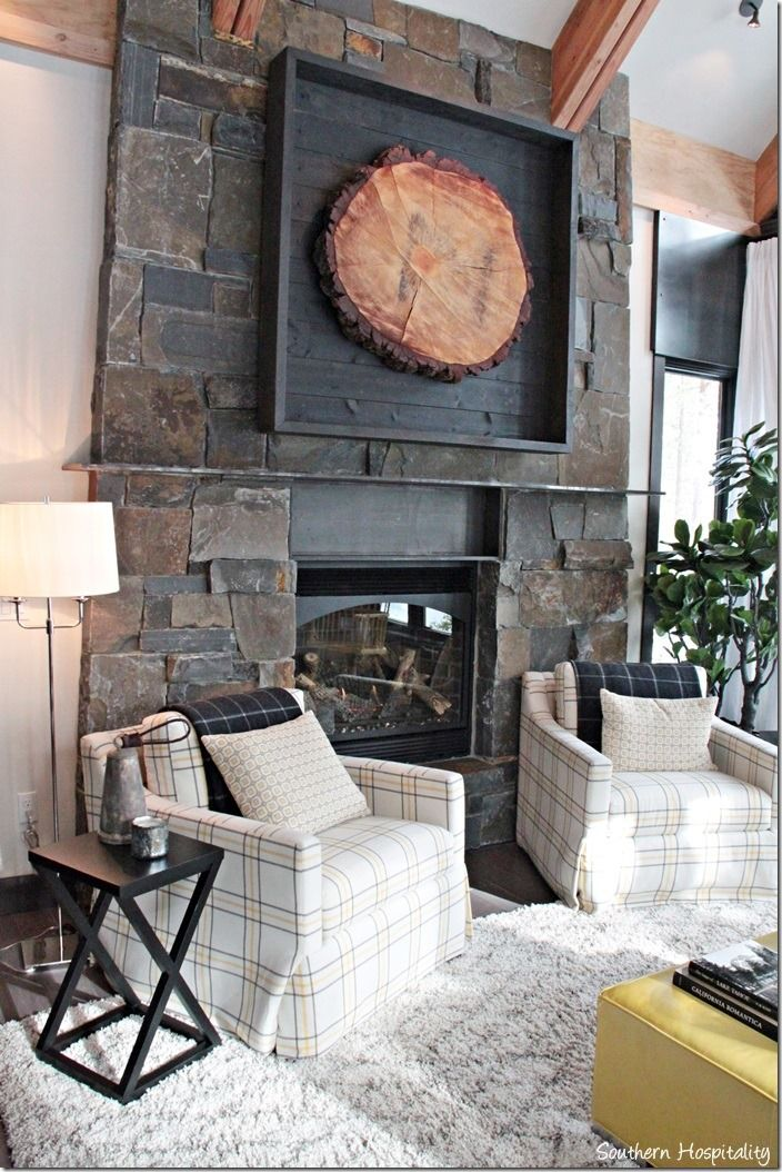 fireplace (2) HGTG Dream home tour. This fireplace is amazing with that rustic slice of the big pine treee like a piece of art.