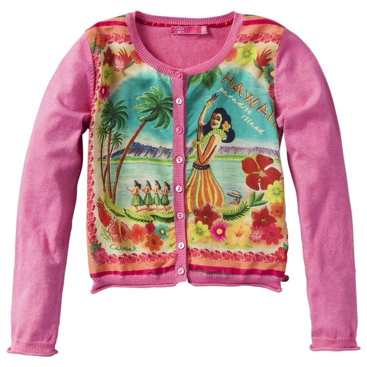 Roze vestje van Cakewalk (model Paloma). Het vestje heeft een prachtige hawaiiaanse fotoprint op de voorzijde en het vestje sluit doormiddel van een aantal roze knoopjes.