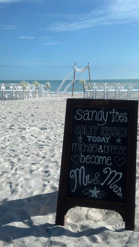 Casa ybel beach wedding with baby's breath and a bamboo arch. Love the chalk board sign!