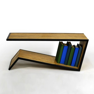 An ingenious open-ended design gives the Slide Coffee Table from FAKTURA a built-in shelf that's the perfect place for books, magazines, board games or your growing DVD collection. Made from bamboo, with a matte black powder-coated steel frame.