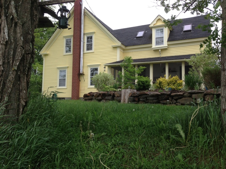 This is the side view of the house. You can see the sunporch and one of the gardens.