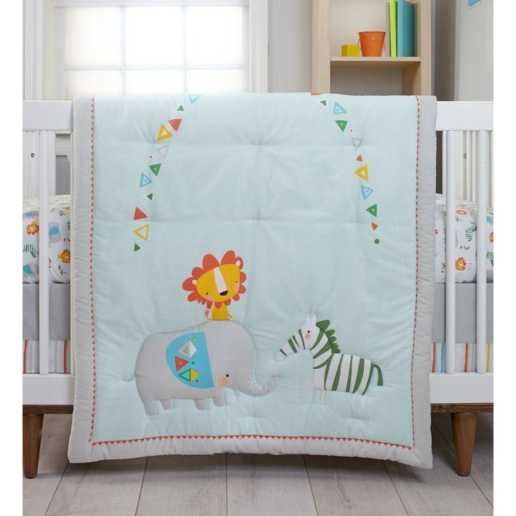 Add a touch of whimsy and wonder with this wild collection including a double-sided comforter featuring an eclectic elephant, zebra, tiger, and colorful pennant against aqua blue on one side and bold stripes on the other; fitted sheet with a playful animal pattern; fitted sheet in bold stripes; coordinating dust ruffle; and a wise tiger wire wall decor. Coordinating items include the Zutano Juba 4-piece Crib Bumper, 2-Pack Crib Sheets, and Ceiling Mobile.