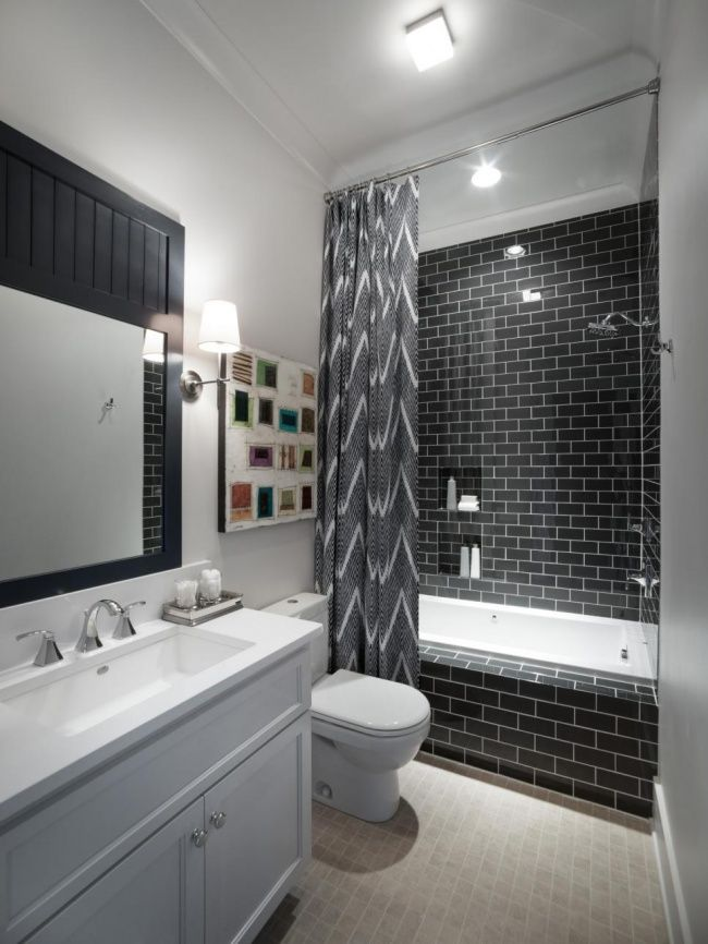 Pictures In Gallery Black subway tile serves as a springboard for this bathroom us clean and sophisticated design and a ceiling height shower curtain fashioned from a blue and