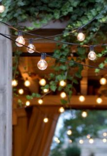 A string of accent lighting adds a romantic touch to an outdoor dinner. #AlfrescoRetreat #Dining