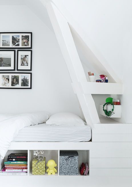In a family's Copenhagen townhouse, custom details like this corner bed with built-in shelving keep the younger generation's spaces playful, but still sophisticated. With four children, utilizing space wisely became a top priority, and the family relies on custom shelving and built-ins to keep clutter at bay. The bed is custom with IKEA frames.  Courtesy of Vipp.  This originally appeared in Black, White, and Gray All Over: Monochromatic Copenhagen Townhouse .