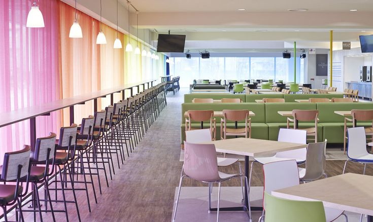 This cool colorful cafeteria brings style to a school. See more on LightsOnline Blog!