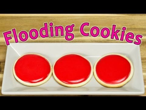 In this video we show you how to decorate cookies by flooding them with royal icing. Decorating cookies with royal icing does require you to know some fundamentals, so make sure you watch our other videos on making sugar cookies and making royal icing (below), if you've never done it before.    How to make Royal Icing: http://youtu.be/RnxHBne-uVo  ...