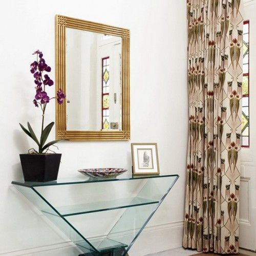 Love everything but the curtain. A big fan of the glass desk below the mirror to store candles, decorative plants, frames, and keys. #design #hallway #livingroom
