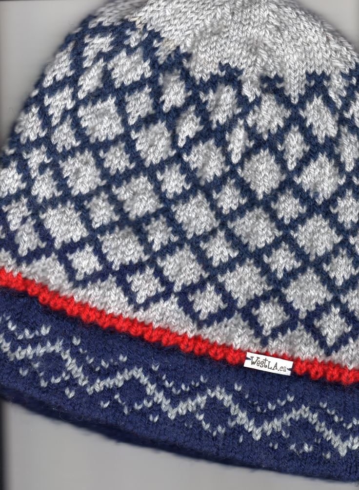 Classic all wool diamond pattern grey and navy blue WestLa original with red trim and double knit mountain peak band. $39.00