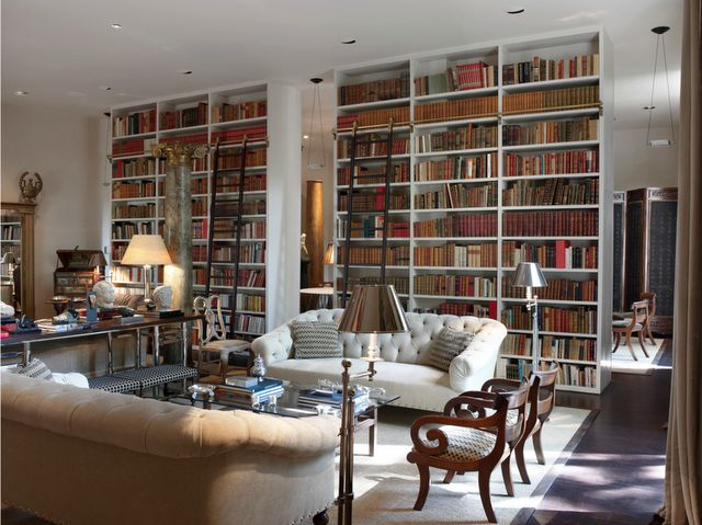floor to ceiling book shelves . library ladder . tufted sofa . elegant chairs . designed by luis bustamante . via my notting hill blog