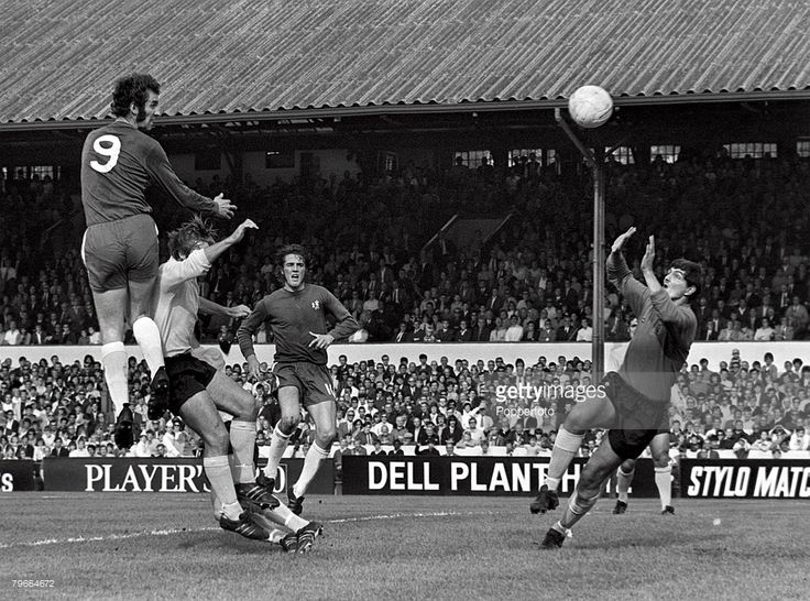 26th September 1970. Chelsea's Peter Osgood leaps up high to score the games only goal past Ipswich goalkeeper David Best while Ian Hutchinson watches on.