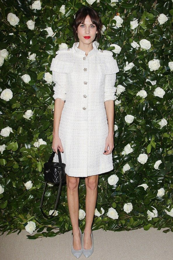 Alexa Chung.. Chanel SS 2013 couture dress and Chanel Resort 2014 bag.. channeling Snow White..